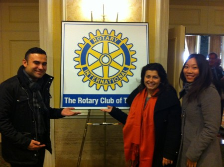 UforChange Representative Chalo poses with Rotaract Toronto members at the Rotary Club of Toronto Meeting